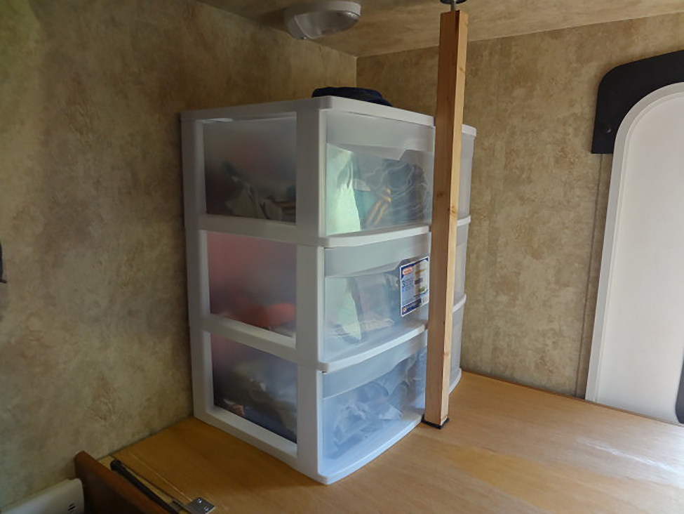 camper bunkhouse storage solution